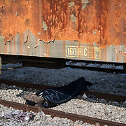 A man sleeping under an abandoned railcar in Idomeni train station. <br /> <br /> Thousands of refugees are stranded in Idomeni unable to cross the border. The facilities are stretched to the limit and the conditions are appalling.