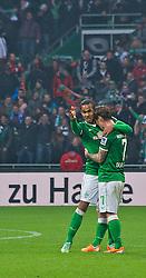 01.03.2014, Weserstadion, Bremen, GER, 1. FBL, SV Werder Bremen vs Hamburger SV, 23. Runde, im Bild Theodor Gebre Selassie (Bremen #23), Ludovic Obraniak (SV Werder Bremen #7) liegen sich nach dem Abpfiff, den Armen // Theodor Gebre Selassie (Bremen #23), Ludovic Obraniak (SV Werder Bremen #7) liegen sich nach dem Abpfiff, den Armen during the German Bundesliga 23th round match between SV Werder Bremen and Hamburger SV at the Weserstadion in Bremen, Germany on 2014/03/02. EXPA Pictures © 2014, PhotoCredit: EXPA/ Andreas Gumz<br /> <br /> *****ATTENTION - OUT of GER*****