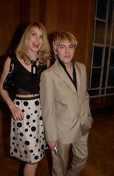 Meredith Ostron and Nick Rhodes, Opening of the Satchi Gallery, County Hall. 15 April 2003. © Copyright Photograph by Dafydd Jones 66 Stockwell Park Rd. London SW9 0DA Tel 020 7733 0108 www.dafjones.com