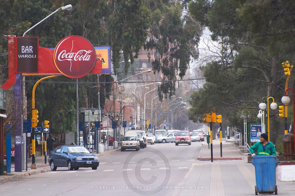 View of the main street. cars and traffic. pedestrians at a pedestrian crossing publicity signs Neuquen, Patagonia, Argentina, South America