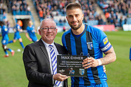 Gillingham FC chairman Paul Scally with a celebratory plaque for Gillingham FC defender Max Ehmer (5) for 200 appearances for the club before the EFL Sky Bet League 1 match between Gillingham and Oxford United at the MEMS Priestfield Stadium, Gillingham, England on 9 March 2019.