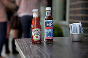 HP Sauce and Heinz Tomato Ketchup bottles outside a cafe in Spitalfields, London. Two icons of the sauce world.