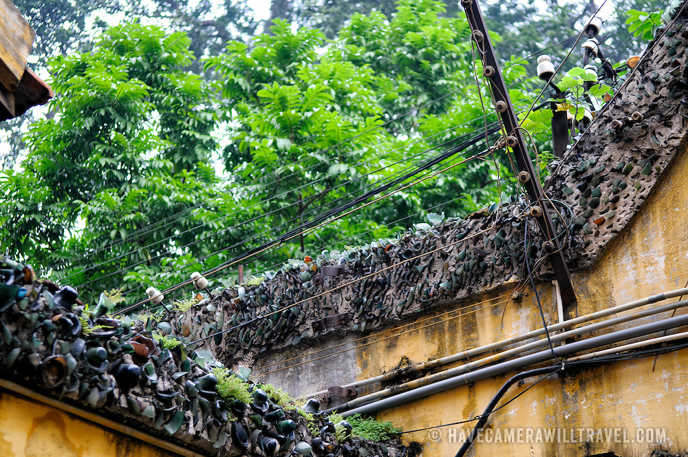 Detail of the broken glass embedded along the top of the high walls on the exterior of Hoa Lo Prison (also known as the Hanoi Hilton). Along with the glass, electrified barbed wire runs along the length of the walls.