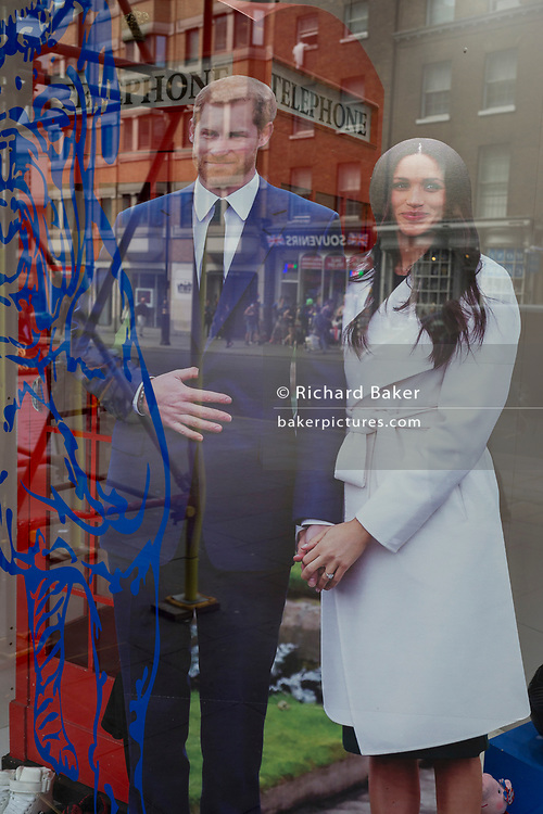A week before the royal wedding between Prince Harry and Meghan Markle, their life-size cut-outs have been positioned behind the outline of a British Bulldog in the window of a tourist trinket shop near Piccadilly Circus, on 9th May, in London, England.