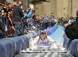 © Licensed to London News Pictures. 04/05/2014; Bristol, UK.  The One Show take part in the 90m long slide by artist Luke Jerram on Bristol's Park Street as part of Keep Sunday Special, an idea by Mayor George Ferguson to close off roads in the city centre for street entertainment.<br /> Photo credit: Simon Chapman/LNP