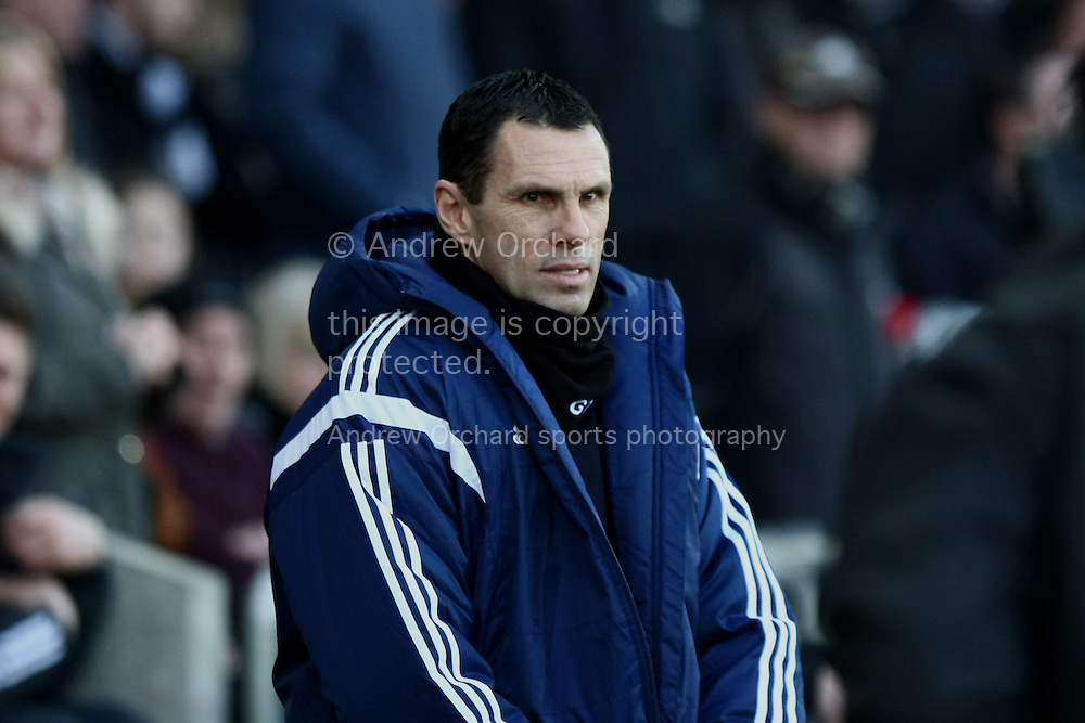 Sunderland manager Gus Poyet looks on ahead of kick off.<br /> Barclays Premier League match, Swansea City v Sunderland at the Liberty stadium in Swansea, South Wales on Saturday 7th Feb 2015.<br /> pic by Mark Hawkins, Andrew Orchard sports photography.