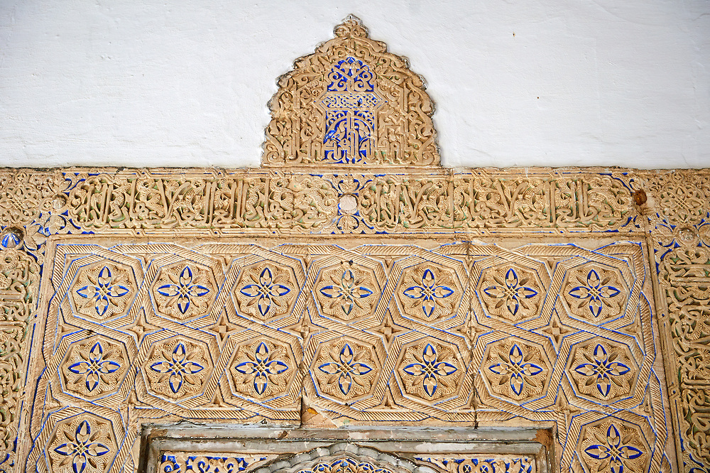 Arabesque Mudéjar style plaster workof the  Alcazar of Seville, Seville, Spain . The Royal Alcázars of Seville (al-Qasr al-Muriq ) or Alcázar of Seville, is a royal palace in Seville, Spain. It was built by Castilian Christians on the site of an Abbadid Muslim alcazar, or residential fortress.The fortress was destroyed after the Christian conquest of Seville The palace is a preeminent example of Mudéjar architecture in the Iberian Peninsula but features Gothic, Renaissance and Romanesque design elements from previous stages of construction. The upper storeys of the Alcázar are still occupied by the royal family when they are in Seville. <br /> <br /> Visit our SPAIN HISTORIC PLACES PHOTO COLLECTIONS for more photos to download or buy as wall art prints https://funkystock.photoshelter.com/gallery-collection/Pictures-Images-of-Spain-Spanish-Historical-Archaeology-Sites-Museum-Antiquities/C0000EUVhLC3Nbgw <br /> .<br /> Visit our MEDIEVAL PHOTO COLLECTIONS for more   photos  to download or buy as prints https://funkystock.photoshelter.com/gallery-collection/Medieval-Middle-Ages-Historic-Places-Arcaeological-Sites-Pictures-Images-of/C0000B5ZA54_WD0s