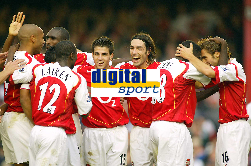 16/10/2004<br />FA Barclays Premiership - Arsenal v Aston Villa - HIghbury<br />Arsenal's Robert Pires (centre) celebrates with his team mates (L to R) Thierry Henry, Sol Campbell, Lauren, Francesc Fabregas, Pires, Kolo Toure and Mathieu Flamini after scoring the decisive 3rd Arsenal goal making the final score 3-1.<br />Photo:Jed Leicester/BPI (back page images)