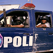 Police on patrol in down-town Port Au Prince, their  tough style of policing is controversial. On Tuesday 12th of January at 16.53pm local time the biggest Earthquake to hit Haiti for 200 years struck with devastating force. 230,000 people were killed, 300,000 injured and 1.2 million left needing emergency shelter. Survivors have lost family, homes, livelihoods and essential services. Hospitals, schools and government buildings were also destroyed'. These pictures are of the survivors three weeks later.