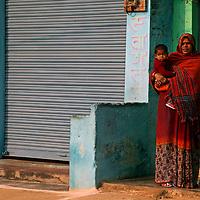 Asia, India, Khajuraho.  Woman in sari holding child.