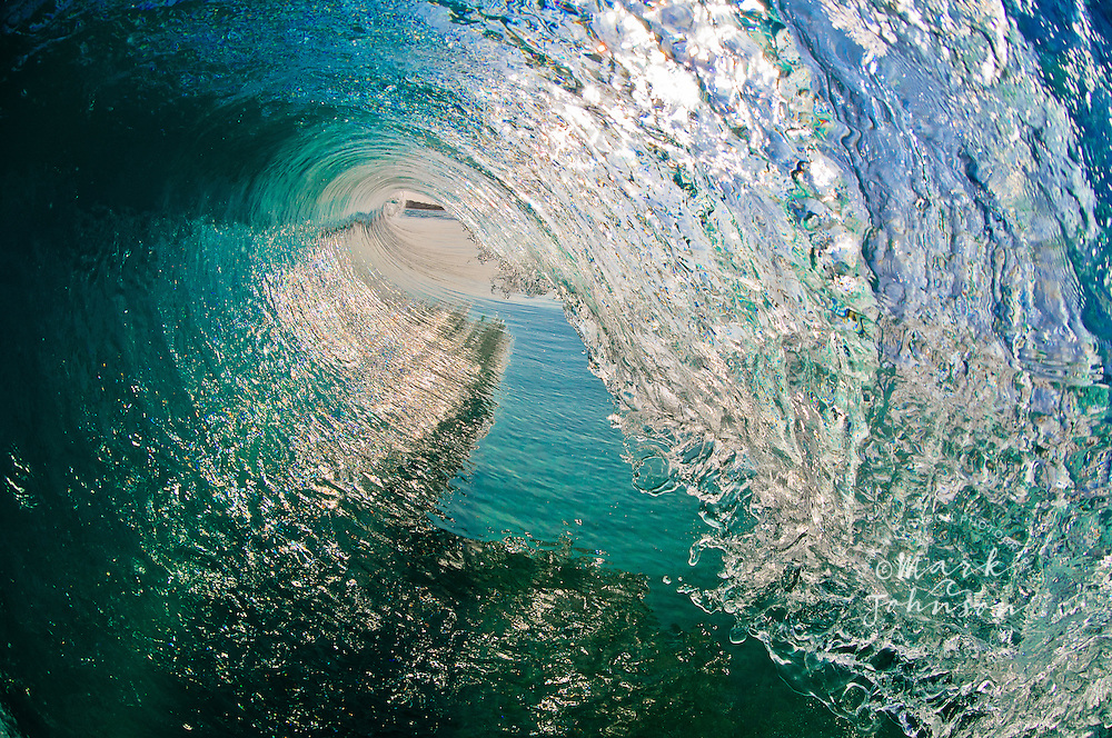 Liquid blue glass transforms into a crystal clear hollow wave. THIS is the view that surfers kill for. And with this on your wall, you can see yourself inside this deep tube every day.