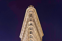 The famous Flatiron Building seen against the night sky in New York City on a warm Fall night.