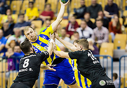 Ziga Mlakar of RK Celje PL vs Senjamin Buric of RK Gorenje and Michal Szyba  of RK Gorenje during handball match between RK Celje Pivovarna Lasko and RK Gorenje Velenje in Eighth Final Round of Slovenian Cup 2015/16, on December 10, 2015 in Arena Zlatorog, Celje, Slovenia. Photo by Vid Ponikvar / Sportida