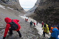 Exploring Diskobutka on the island of Edgeoya in the Svalbard archipelago which supports a variety of wildlife including reindeer, arctic fox and a kittiwake colony