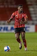 Lincoln City Defender Timothy Eyoma (22) during the EFL Sky Bet League 1 match between Lincoln City and Shrewsbury Town at Sincil Bank, Lincoln, United Kingdom on 15 December 2020.