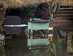 © Licensed to London News Pictures. 01/02/2021. Wraysbury, UK. Flood Water from the the Colne Brook surrounds garden furniture as it approaches residential properties near Wraysbury in Berkshire, as  large parts of the UK experience more wet conditions. Photo credit: Ben Cawthra/LNP