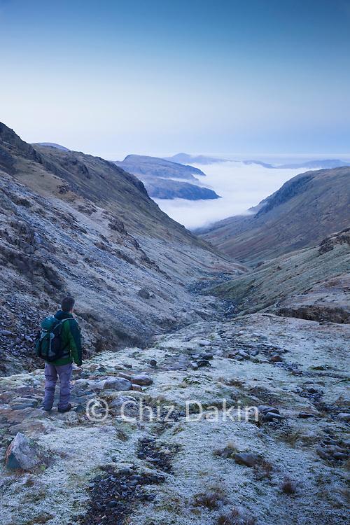 Walker looking down Ruddy/Grains Gill valley to Seathwaite
