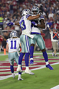 Dallas Cowboys wide receiver Dez Bryant (88) leaps and celebrates with Dallas Cowboys wide receiver Terrance Williams (83) after Bryant catches a 15 yard second quarter touchdown for a 14-7 Cowboys lead during the 2017 NFL week 3 regular season football game against the against the Arizona Cardinals, Monday, Sept. 25, 2017 in Glendale, Ariz. The Cowboys won the game 28-17. (©Paul Anthony Spinelli)