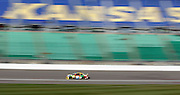 NASCAR Sprint Cup Series driver Kyle Busch heads toward turn one during a practice run at Kansas Speedway in Kansas City, Kan., Saturday, Oct. 4, 2014. (AP Photo/Colin E. Braley)