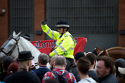 "© Licensed to London News Pictures . 22/08/2015 . Manchester , UK . Far-right nationalist group , "" North West Infidels "" and Islamophobic , anti-Semitic and white supremacist supporters , hold a rally in Manchester City Centre . Photo credit : Joel Goodman/LNP"