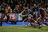 Blaine Scully of Cardiff Blues dives over to score a spectacular try in the 2nd half.  Guinness Pro12 rugby match, Cardiff Blues v Scarlets at the BT Cardiff Arms Park in Cardiff, South Wales on Friday 28th October 2016.<br /> pic by Andrew Orchard, Andrew Orchard sports photography.