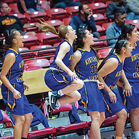 Kirtland Central Bronco Peanut Dryden (2), center and the Bronco bench erupt in the final moments of the fourth quarter against the St. Pius X Sartans during a District 5A quarterfinal at The Pit in Albuquerque Tuesday.