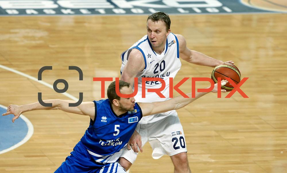 Anadolu Efes's Dusko Savanovic (R) and Turk Telekom's Muratcan Guler (L) during their Turkish Basketball League match Anadolu Efes between Turk Telekom at Arena in Istanbul, Turkey, Wednesday, January 04, 2012. Photo by TURKPIX