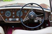 Dashboard, temperature gauge, rev counter, speedometer - speedo - car radio and steering wheel of Alvis TD21 DHC classic car