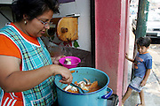 Alma Casales cooks crab soup at her sister's restaurant in Cuernavaca, Mexico for both the patrons and her family. Hungry Planet: What the World Eats (p. 223).