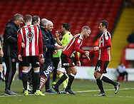 Matt Done of Sheffield Utd replaces Danny Lafferty of Sheffield Utd during the English League One match at Bramall Lane Stadium, Sheffield. Picture date: December 31st, 2016. Pic Simon Bellis/Sportimage