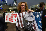 Angela McWilliams of Lewisville Texas, holds two signs to protest President Trump's firing of Attorney General Jeff Sessions. The protest, part of the red Line nationwide protests is a reaction to Trump's firing of Sessions, removing Deputy Attorney General Rod Rosenstein's oversight of  Special Counsel Robert Mueller's investigation of the White. Trump has replaced Sessions with Matthew Whitaker a GOP loyalist.
