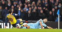 Manchester City's Sergio Agüero is tackled by Arsenal's Santi Cazorla<br /> <br /> Photographer Dave Howarth/CameraSport<br /> <br /> Football - Barclays Premiership - Manchester City v Arsenal - Sunday 18th January 2015 - Etihad stadium - Manchester<br /> <br /> © CameraSport - 43 Linden Ave. Countesthorpe. Leicester. England. LE8 5PG - Tel: +44 (0) 116 277 4147 - admin@camerasport.com - www.camerasport.com