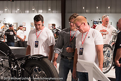 Paul Yaffe, Sean Verna and Earl LeVere check out the R5 Homage during the Industry party night for Michael Lichter's tattoo themed Skin & Bones Motorcycles as Art exhibition at the Buffalo Chip during the annual Sturgis Black Hills Motorcycle Rally.  SD, USA.  August 7, 2016.  Photography ©2016 Michael Lichter.