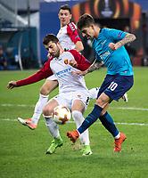 ST PETERSBURG, RUSSIA – NOVEMBER 23, 2017. UEFA Europa League Group L Round 5 football match at Saint Petersburg Stadium. Zenit St Petersburg 2 -1 FK Vardar. FK Vardar's Besir Demiri (L) and FC Zenit St Petersburg's Emiliano Rigoni (R).