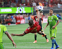 July 15, 2018 - Atlanta, GA, USA - Atlanta United midfielder Josef Martinez attempts a scissor kick against the Seattle Sounders that goes wide, with Jordy Delem looking on, during the second half on Sunday, July 15, 2018, in Atlanta, Ga. Martinez scored his team's only goal in a 1-1 tie. (Credit Image: © Curtis Compton/TNS via ZUMA Wire)