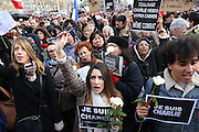 """A massive public rally """"Cry for Freedom"""" takes place in central Paris on Sunday afternoon. Young beautiful woman protests strongly holding pen aloft to support Charlie. The rally brought in people of all colors and creeds from both France and abroad. Many were carrying placards with various slogans. This demonstration happened the weekend after armed gunmen attacked the offices of Charlie Hebdo, killing twelve people, including the editor and celebrated cartoonists; four more are in critical condition. It is the dealiest terror attack in France for over fifty years. Charlie Hebdo is a satirical publication well known for its political cartoons. The jihadists responsible were killed by police in several shootouts on the Friday afternoon. <br /><br />As a solidarity actions with the deaths at Charlie Hebdo many placards read """"Je suis Charlie"""" translating as """"I am Charlie (Hebdo)"""". Demonstrators held aloft pens, brushes and crayons, symbolizing the profession of journalists and cartoonists who were killed. Many pens were placed in a shrine with candles in the square. Some protesters also refused to ally themselves with Charlie Hebdo."""