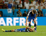 Argentina's Javier Mascherano lies on the pitch during the 2014 FIFA World Cup Final match at Maracana Stadium, Rio de Janeiro<br /> Picture by Andrew Tobin/Focus Images Ltd +44 7710 761829<br /> 13/07/2014