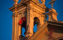 MALTA GOZO SANNAT JUL00 - Spectators observe the procession from a belltower of Sannat Church.. . jre/Photo by Jiri Rezac. . © Jiri Rezac 2000. . Tel:   +44 (0) 7050 110 417. Email: info@jirirezac.com. Web:   www.jirirezac.com