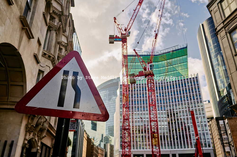 Construction work in Fenchurch Street showing The Walkie Talkie building and Fen Court building, London, England - 18 February 2021