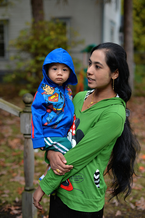 Mother and her young child outside of their home in North Hill.