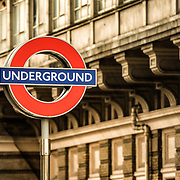 The famous London Underground logo above a station in central London, United Kingdom. With copyspace in right of frame.
