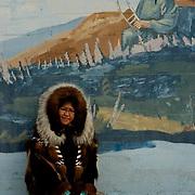 Native Lady wearing traditional fur coat in Alaska.