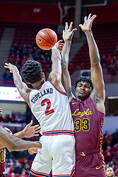NORMAL, IL - January 19: Zach Copeland passes the ball past the outstreched arms of Franklin Agunanne during a college basketball game between the ISU Redbirds and the Loyola University Chicago Ramblers on January 19 2020 at Redbird Arena in Normal, IL. (Photo by Alan Look)