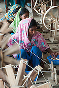 Bangladesh, Jamuna River, (called the Brahmaputra River in India) near the town of Gaibanda. This is the boat based Friendship non-profit organization (NGO), who provide health care and vocational traing  for locals. The women are weaving cloth to be sold  through this community based project.