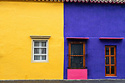 Brightly painted colonial style homes in Tlacotalpan, Veracruz, Mexico. The tiny town is painted a riot of colors and features well preserved colonial Caribbean architectural style dating from the mid-16th-century.