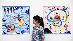 © Licensed to London News Pictures. 25/09/2019. LONDON, UK. Artist Ming Lu poses with some of her ornate tapestries at the preview of START, a contemporary art fair comprising eclectic works from a variety of international emerging artists.  The fair takes place at the Saatchi Gallery in Chelsea 26 to 29 September 2019.  Photo credit: Stephen Chung/LNP