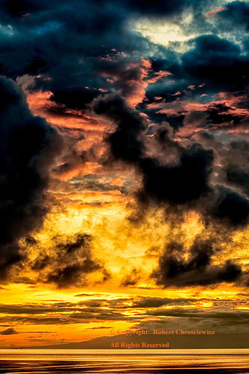 Dynamic Display:  An unusual cloud configuration at sunrise leads to a most colourful and dynamic display over the South Pacific, Bunudan (near Amed) - Bali Indonesia.