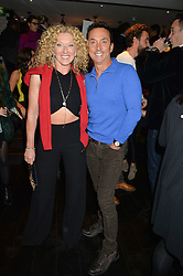BRUNO TONIOLI and KELLY HOPPEN at a party to celebrate the publication of Honestly Healthy Cleanse by Natasha Corrett held at Tredwell's Restaurant, 4a Upper St.Martin's Lane, London on 14th January 2015.