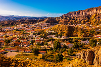 Rock formations, the town of Gorafe and the surrounding Gorafe Desert, Granada Province, Andalusia, Spain.
