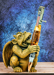 An ink pen with a wooden carved shaft and a 30-caliber rifle shell on the end in a gargoyle pen holder.